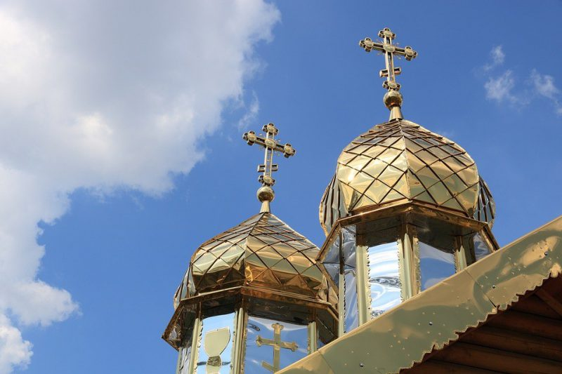 Crosses affixed to the domes of an Orthodox Church.