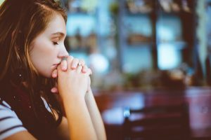 A woman praying the Jesus Prayer
