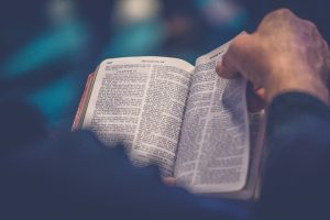 Man deepens his spiritual life by reading the Bible.