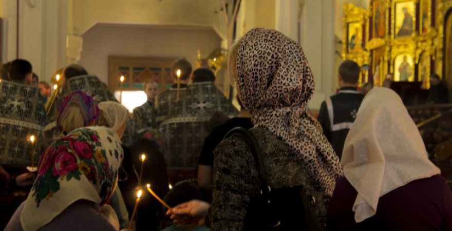 Congregation gathering for prayer in an Orthodox church.